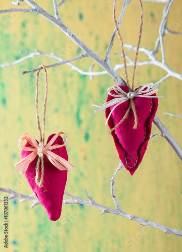 Heart from cloth on wood background