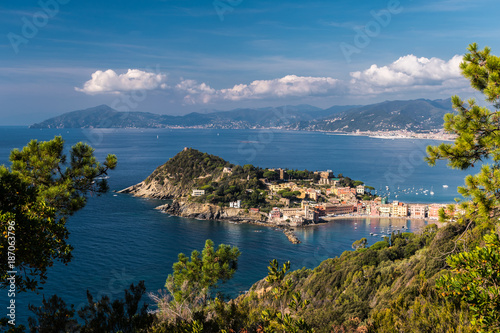 Fotobehang Liguria Panoramic view of Sestri Levante and its promontory; coastline of Liguria in the background
