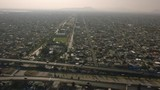 Aerial shots of Mexico City showing it's immensity and over-population. - 187070587
