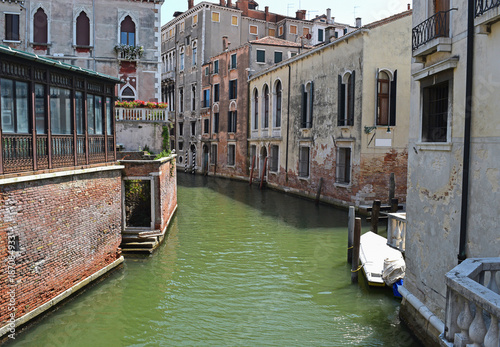 Tuinposter Venetie Old buildings and a canal in Venice, Italy