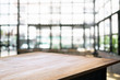 empty wooden desk over blurred coffee shop cafe background - 187087908