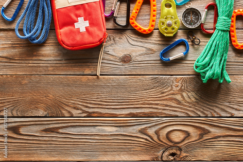 Foto Murales Travel items for hiking over wooden background