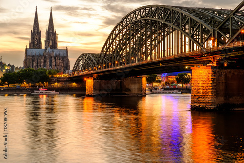 Cologne Cathedral and Hohenzollern Bridge at sunset, Germany