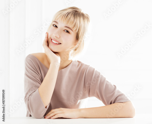 young smiling beautiful woman in living room