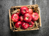 box with ripe red apples. - 187106960
