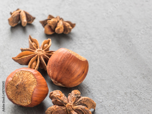 Nuts hazelnuts and anise seeds on a black background. Aniseed
