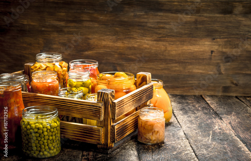 Foto op Canvas Snelle auto s Preserves mushrooms and vegetables in a box.