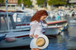Portrait of a beautiful young female tourist in a summer vacation in  Croatia