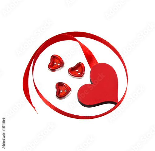 thin red satin ribbon is twisted and cut on white background buttons in the form of hearts