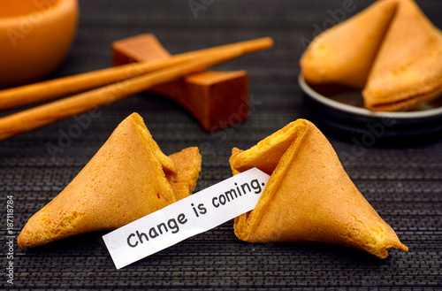 Paper strip with phrase Change is coming from fortune cookie