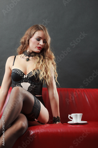 Woman wearing sexy lingerie having coffee cup - 187124170