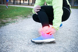 Injury running concept . Man feeling leg pain while training