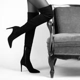 Girl in Hessian boots in high heels in studio - 187136741