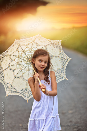 young girl with umbrella sunny day