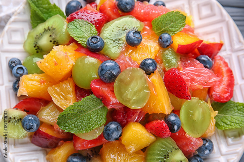 Plate with delicious fruit salad, closeup