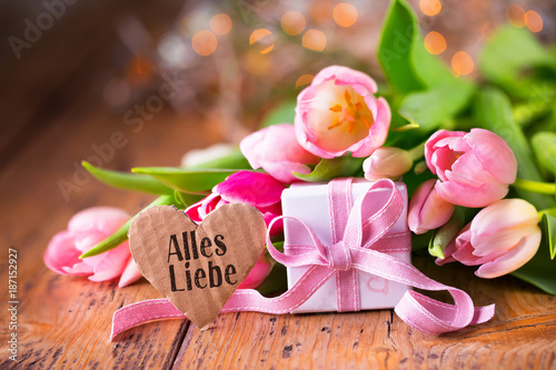 Beautiful bouquet of tulips with gift box and heart