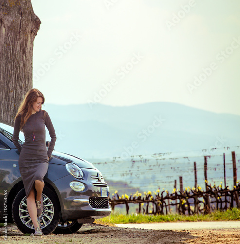 Poster Toscane girl travelling by car in Tuscany