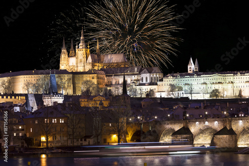 Fireworks above night colorful snowy Prague gothic Castle with Charles Bridge, Czech republic - 187156366