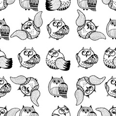 Seamless pattern of hand drawn sketch style owls. Vector illustration.