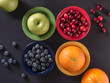 Fresh Fruits In Colorful Bowls