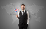 Man standing with flag and map background - 187171142
