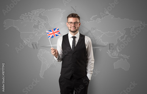 Man standing with flag and map background
