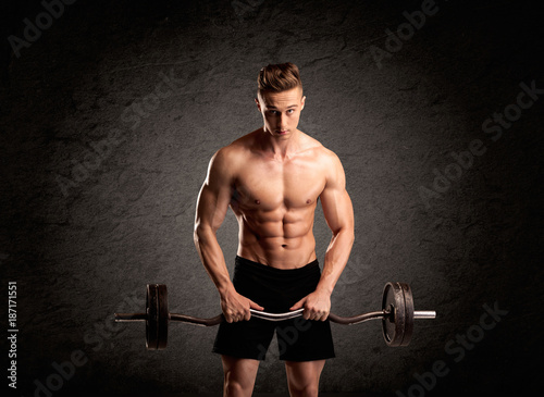 Sexy weight lifter guy showing muscles