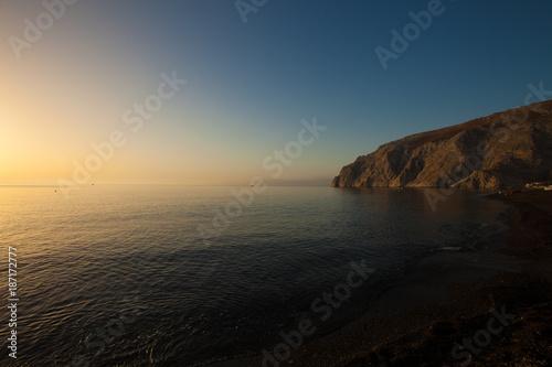 Sea cliff and calm sea