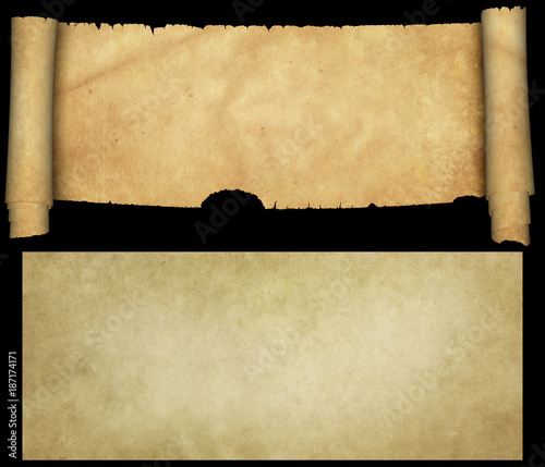 Antique scroll with torn edges and old paper sheet on black background.
