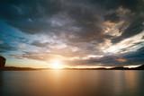 Sunset over lake. - 187174776