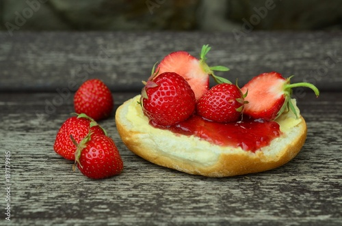 Strawberries with leaves. Isolated on a white background on the cake