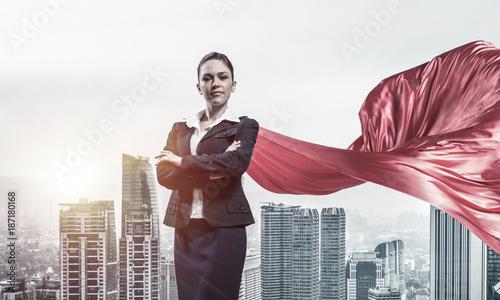 Foto op Aluminium Kasteel Concept of power and sucess with businesswoman superhero in big