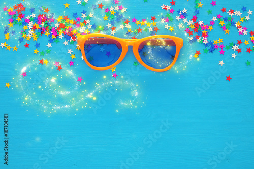 Carnival celebration concept with funny glasses. Top view.