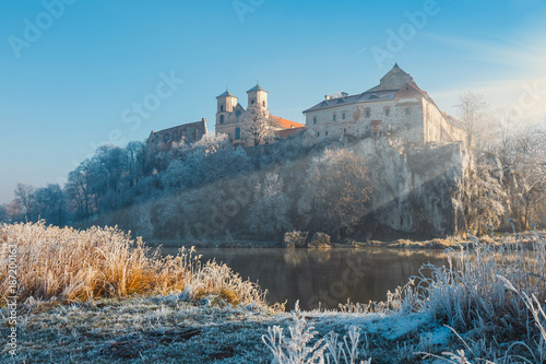 Hoarfrost on the grass and the benedictine abbey in Tyniec in the background, Cracow, Poland