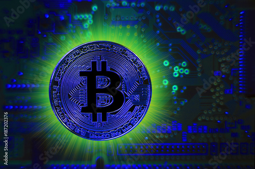 Bitcoin, with a blue coin on a blue digital background