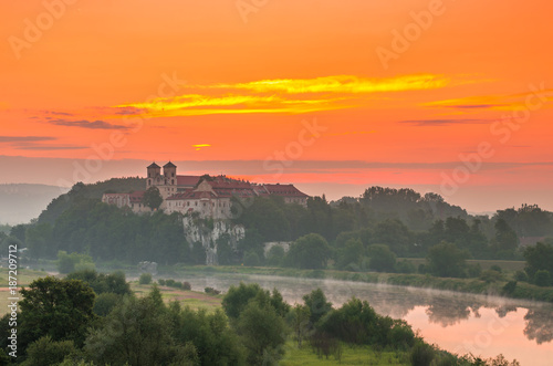 Fotobehang Oranje eclat Colorful morning landscape in the morning, Poland, Tyniec near Krakow