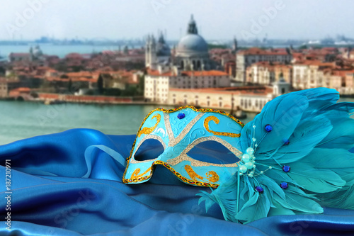 Foto op Canvas Snelle auto s Image of elegant venetian mask on silk fabric in front of blurry Venice background.
