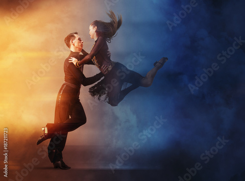 Pair of dancers dancing ballroom