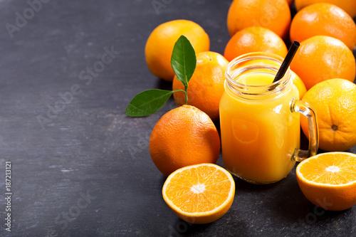 Fotobehang Sap glass jar of fresh orange juice with fresh fruits