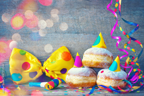 Carnival donuts with paper streamers and party bow tie - 187220344