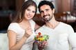 Couple enjoying a healthy salad together