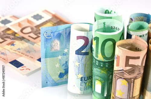 Euro banknotes rolled on a white background