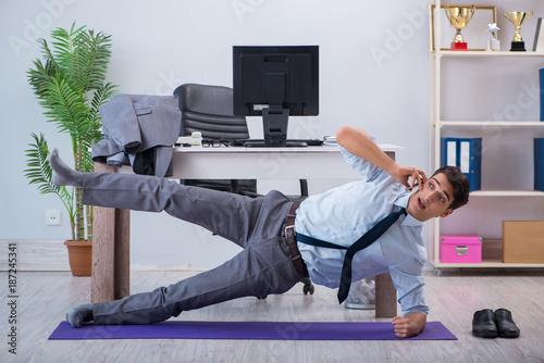 Fridge magnet Businessman doing sports in office during break