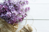 lilac flowers on white old wooden background - 187250154