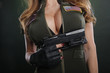 Busty girl behind big pistol