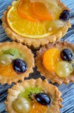 Sweet delicious meal. Muffins with colorful and fresh fruits. - 187266723