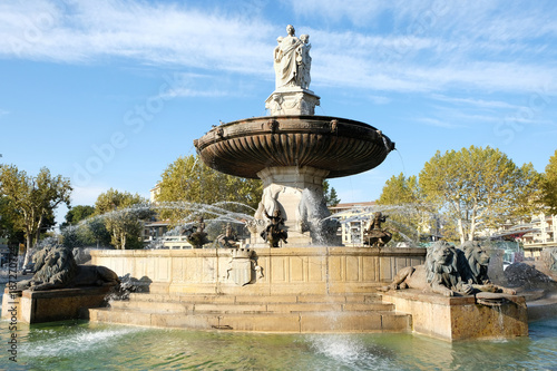 Aix-en-Provence, France - October 18, 2017 : the famous fountain Rotonde at the base of the Cours Mirabeau market street