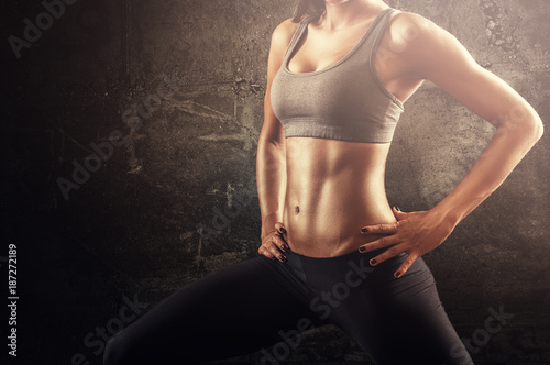 Shaped woman muscular fit body stretching position