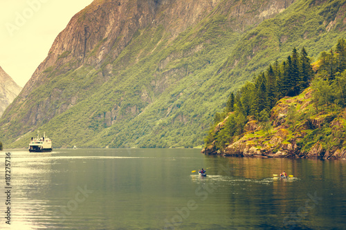 fjord in Norway and people kayaking