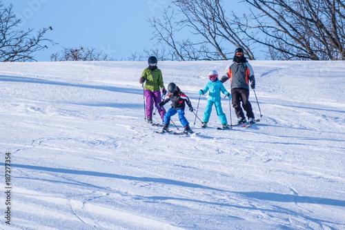 fototapeta na ścianę People are having fun in downhill skiing and snowboarding